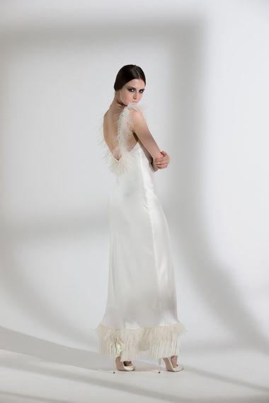 "Iris Ostrich & Fringe Dress by <a href=""https://www.halfpennylondon.com/"" target=""_blank"">Halfpenny London</a>"