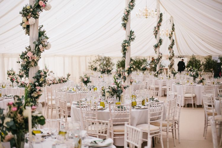 Floral Arrangements On Marquee Poles By Whites Flowers
