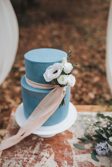 Blue Wedding Cake With Pink Ribbon