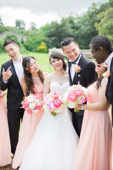Bridesmaids In Floor Length Pink Gowns