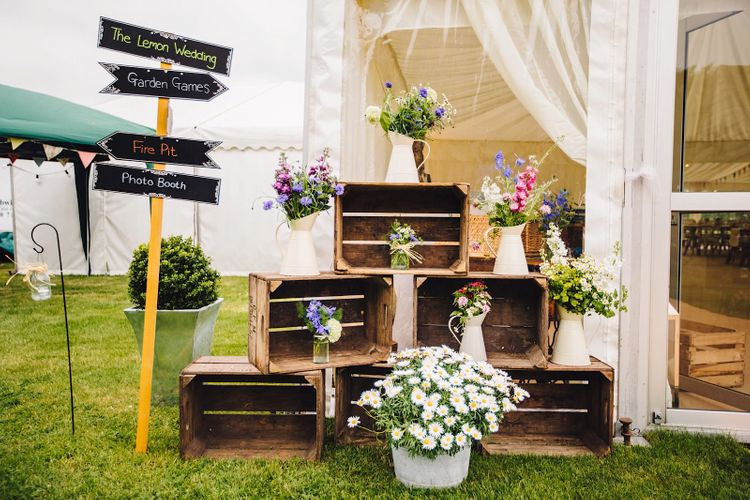 Wooden Crate Wedding Flowers with Wedding Sign   DIY At Home Marquee Wedding   J S Coates Wedding Photography