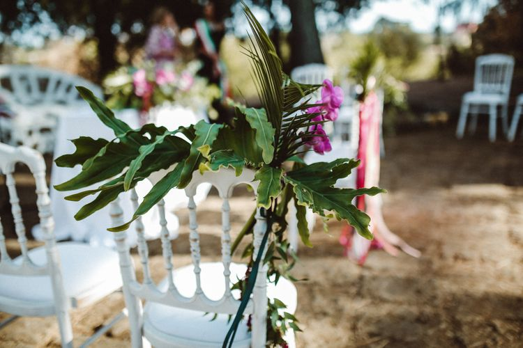 Chair Back Flowers | Tropical Green & Fuchsia Pink Outdoor Wedding at Castellina de Miremont, Italy Planned & Styled by Come le Ciliegie Wedding & Events | Images by Effeanfotografie | Film by Headshot Weddings