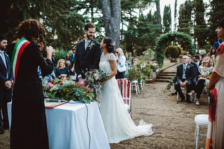 Outdoor Wedding Ceremony | Bride in Jenny Packham Dolly Bridal Gown | Tropical Green & Fuchsia Pink Wedding at Castellina de Miremont, Italy Planned & Styled by Come le Ciliegie Wedding & Events | Images by Effeanfotografie | Film by Headshot Weddings