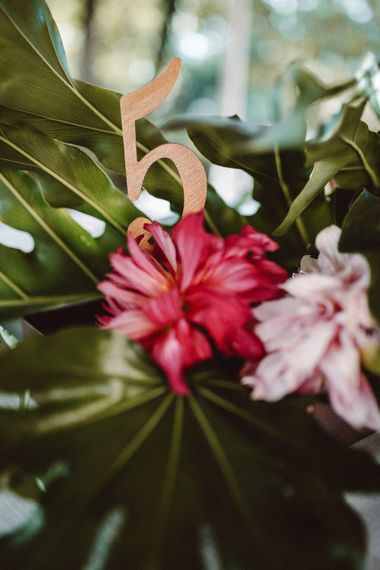 Wooden Table Number | Tropical Green & Fuchsia Pink Outdoor Wedding at Castellina de Miremont, Italy Planned & Styled by Come le Ciliegie Wedding & Events | Images by Effeanfotografie | Film by Headshot Weddings