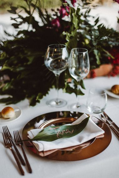 Place Setting with Gold Platter | Tropical Green & Fuchsia Pink Outdoor Wedding at Castellina de Miremont, Italy Planned & Styled by Come le Ciliegie Wedding & Events | Images by Effeanfotografie | Film by Headshot Weddings