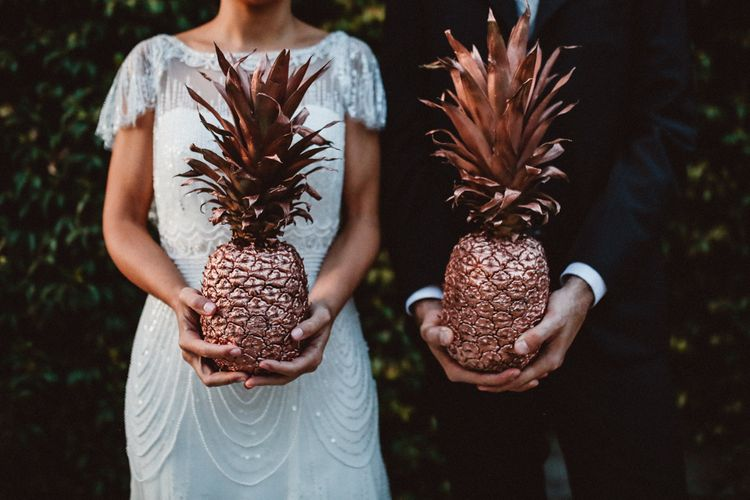Gold Spray Painted Pineapples | Bride in Jenny Packham Dolly Bridal Gown | Groom in Four Stroke Suit | Tropical Green & Fuchsia Pink Outdoor Wedding at Castellina de Miremont, Italy Planned & Styled by Come le Ciliegie Wedding & Events | Images by Effeanfotografie | Film by Headshot Weddings