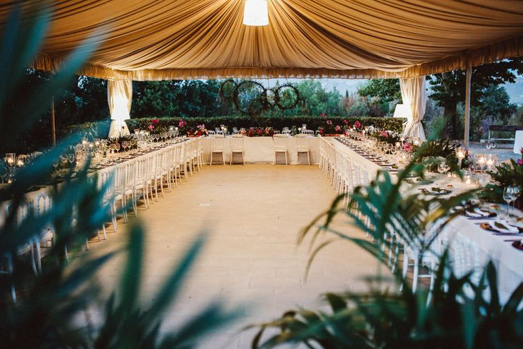 Reception Decor | Greenery Hoops Top Table Backdrop | Tropical Green & Fuchsia Pink Outdoor Wedding at Castellina de Miremont, Italy Planned & Styled by Come le Ciliegie Wedding & Events | Images by Effeanfotografie | Film by Headshot Weddings