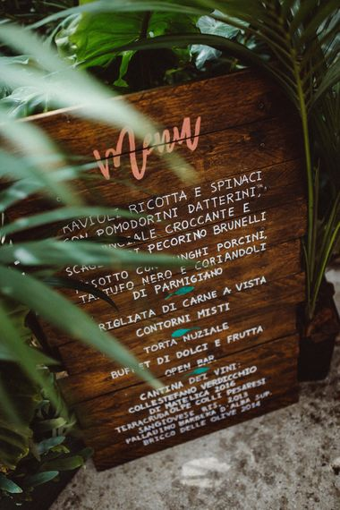 Wooden Menu Board | Tropical Green & Fuchsia Pink Outdoor Wedding at Castellina de Miremont, Italy Planned & Styled by Come le Ciliegie Wedding & Events | Images by Effeanfotografie | Film by Headshot Weddings