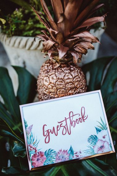 Guest Book Sign & Golden Pineapple | Tropical Green & Fuchsia Pink Outdoor Wedding at Castellina de Miremont, Italy Planned & Styled by Come le Ciliegie Wedding & Events | Images by Effeanfotografie | Film by Headshot Weddings