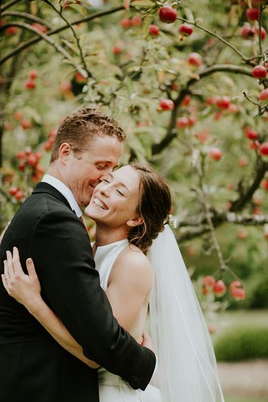 Love under the apple tree. So beautifully English for this garden wedding.