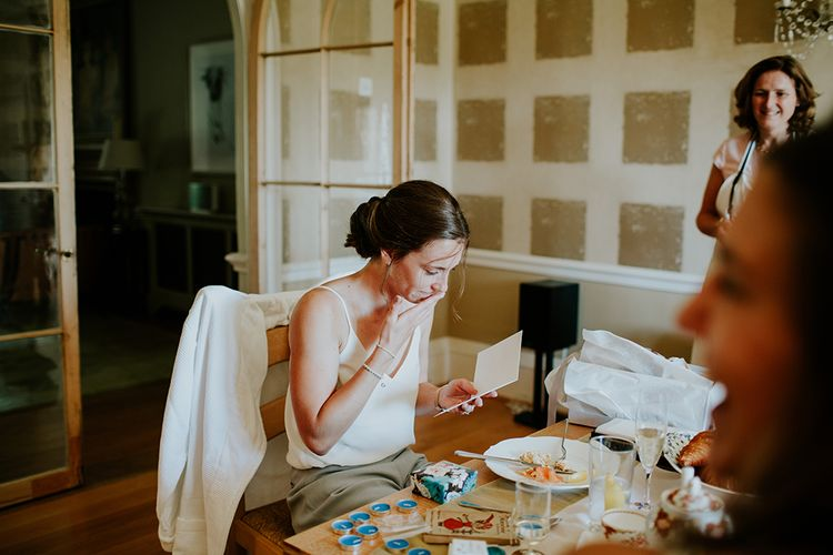 Bride opening something lovely