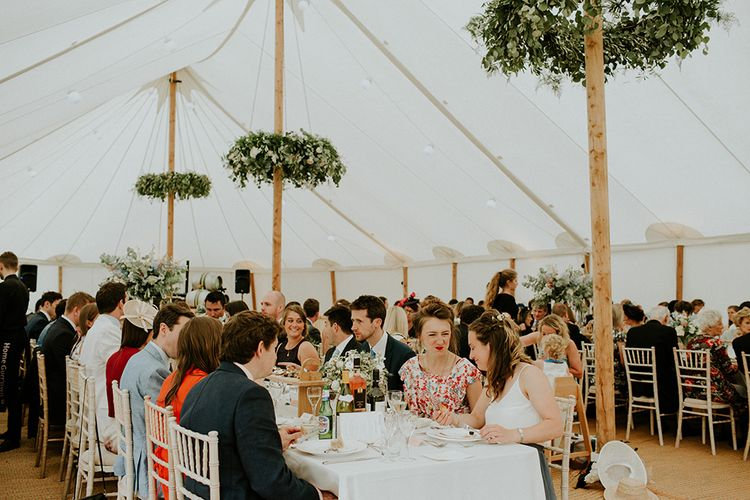 Beautiful florals by Florist in the Forest in decorated Sperry Tent