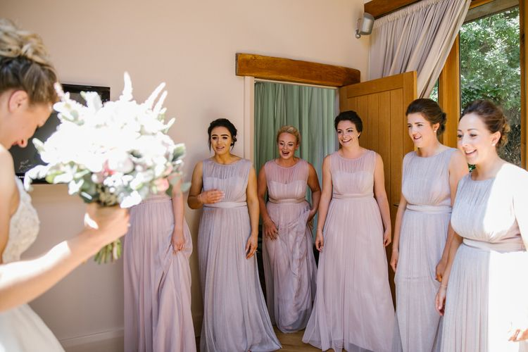 Bridesmaids In Pink & Purple Dresses