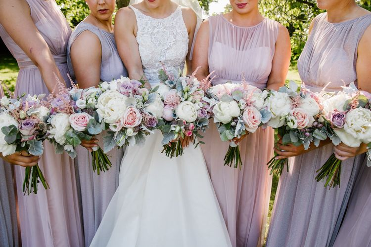 Bride In Sassi Holford With Bridesmaids In Purple & Pink Maxi Dresses From Debenhams