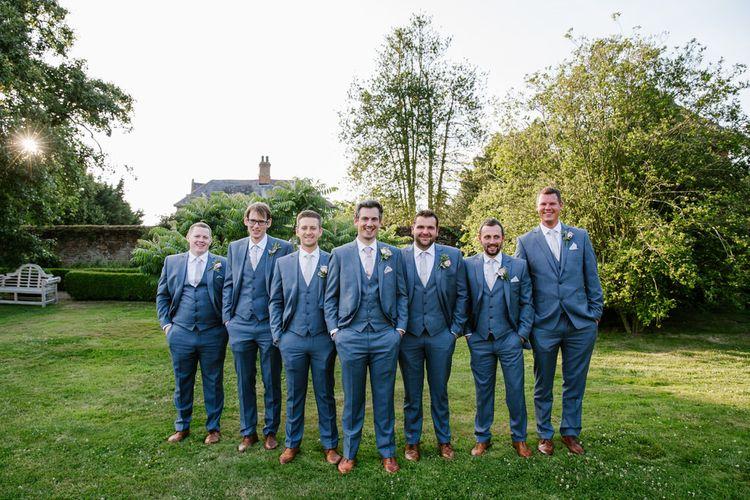 Groom & Groomsmen In Grey Suits Moss Bros