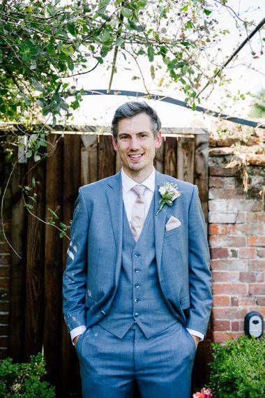 Groom In Light Grey Suit From Moss Bros