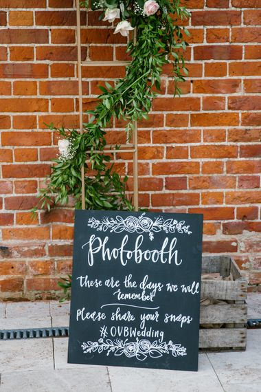 DIY Photobooth At Wedding With Floral Arch