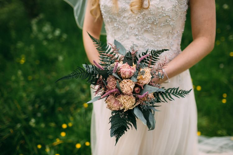 Bride in Maggie Sottero Wedding Dress with Folky Dolkey Dried Flower Bouquet