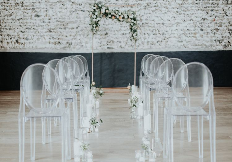 Perspex Chairs & Floral Ceremony Arch For Wedding
