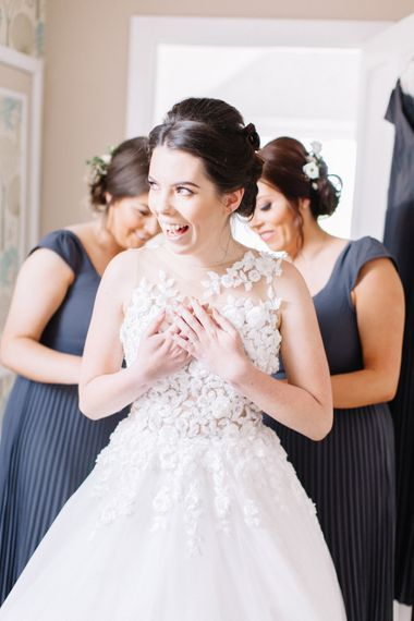 Getting Ready | Bride in Pronovias Gown | Bridesmaids in Grey ASOS Dresses | Bowtie and Belle Photography