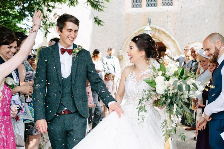 Confetti Moment | Pronovias Taciana Bridal Gown | Groom in Tweed Suit | Greenery & White Marquee Wedding at The Villa, Levens with Copper Details | Bowtie and Belle Photography