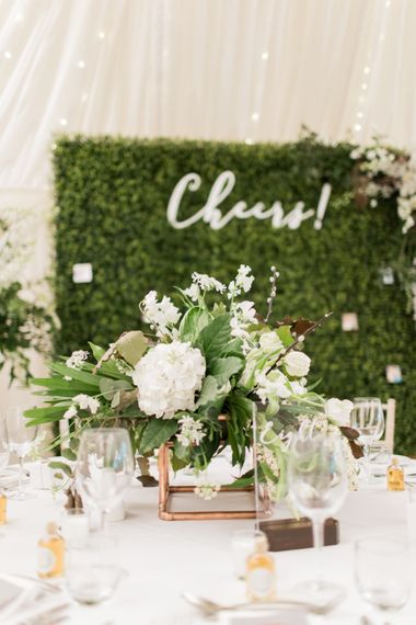 Faux Hedge Backdrop & Floral Centrepiece| Greenery & White Marquee Wedding at The Villa, Levens with Copper Details | Bowtie and Belle Photography