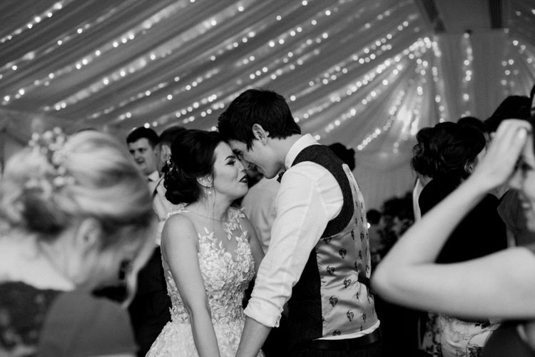 First Dance | Pronovias Taciana Bridal Gown | Groom in Tweed Suit | Greenery & White Marquee Wedding at The Villa, Levens with Copper Details | Bowtie and Belle Photography