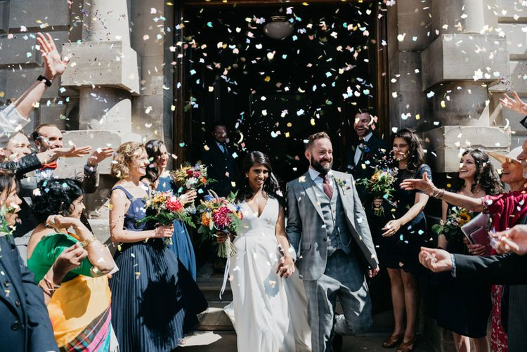Confetti Moment | Bride in Charlie Brear | Groom in Reiss Suit | Guildhall in Bath | Andrew Brannan Photography