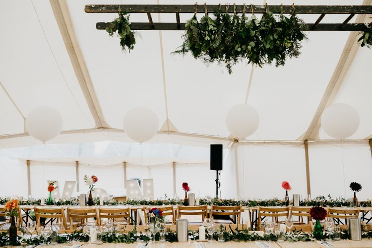 Marquee Wedding | Trestle Tables | Wild Flowers in Jars | Balloons | Hanging Greenery Installations | Andrew Brannan Photography
