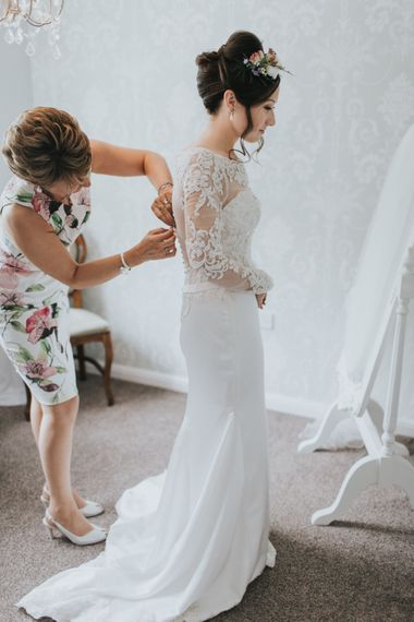 Bride In Lace Dress With Long Lace Sleeves