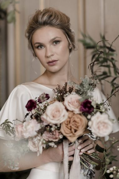 Beautiful Bride with Dewy Makeup Holding a Romantic Wedding Bouquet