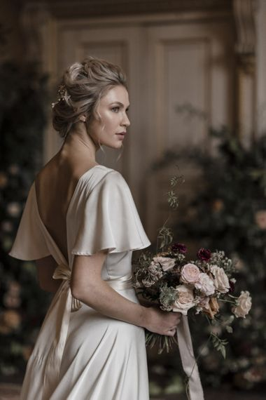 Bride with Twisted Updo in a Silk Wedding Dress with Batwing Sleeves