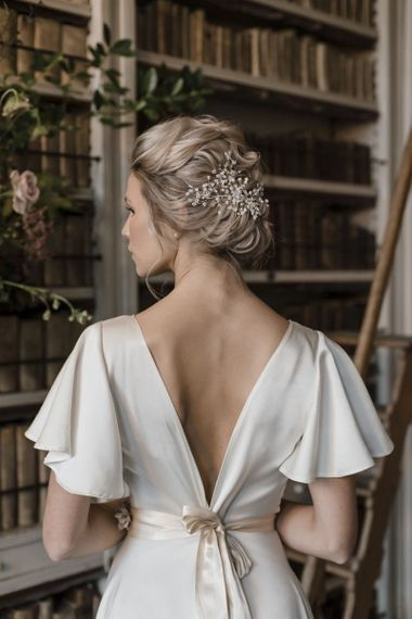 Bride in V Back Wedding Dress with Elegant Bridal Up do with Pearl Hair Vine