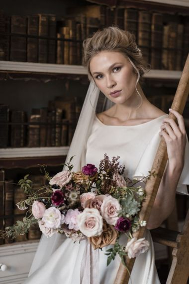 Bride with Natural Makeup and Up Do Holding a Romantic Rose Wedding Bouquet