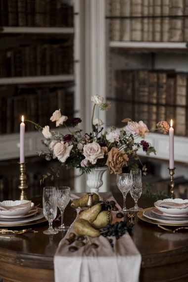 Elegant table Decor with Candlesticks Taper Candles, Muted Flower Arrangement and Fruit