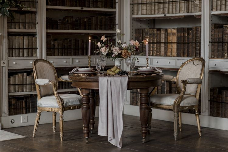 Elegant Sweetheart Table with Linen Table Runner, Candlesticks and Ornate Tableware