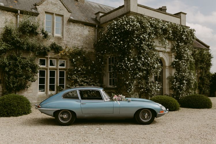 Blue Wedding Car on the Venue's Driveway