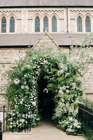 Church Doorway Decorated with White and Green Wedding Flowers