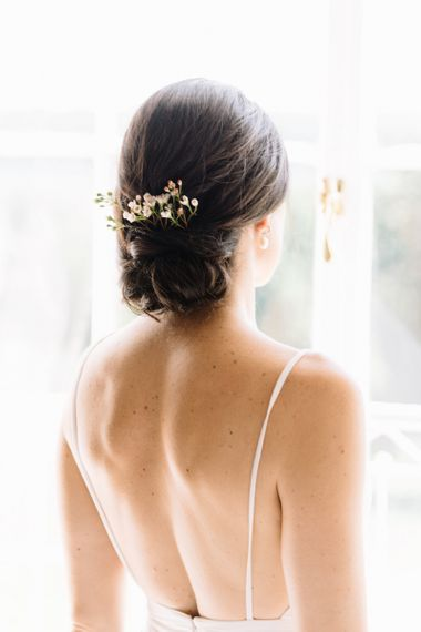 Low pinned up bun bridal Hairstyle with comb hair accessory