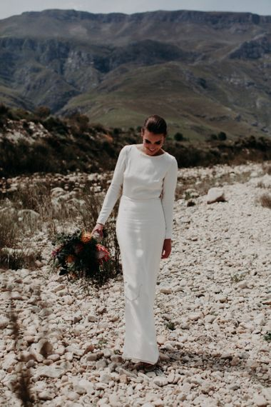 Chic Bride in Fitted Minimalist Wedding Dress with Long Sleeves and Low Back