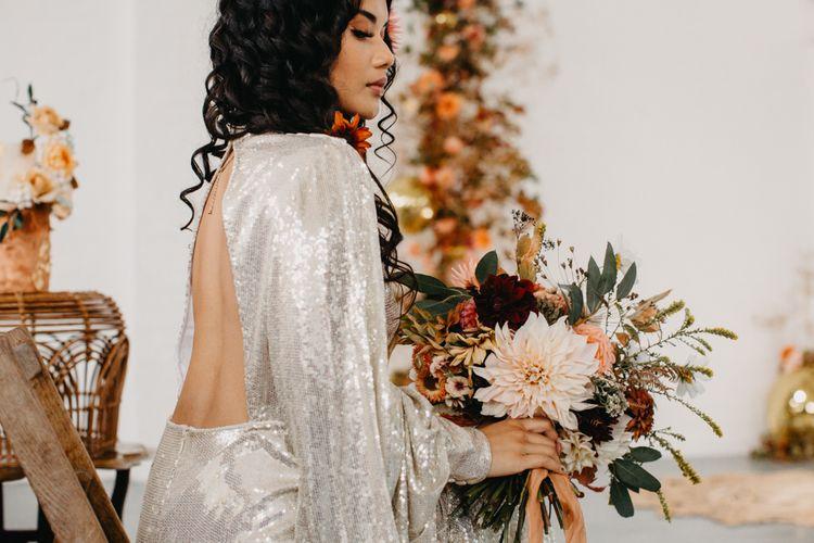 Bride in silver sequin wedding dress for 70s Disco wedding inspiration