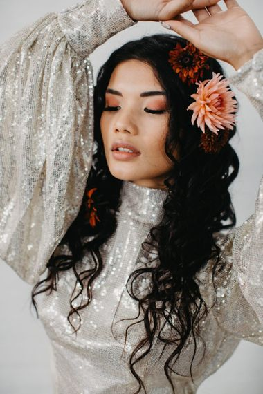 Wedding makeup and wavy hair for 70s disco inspiration