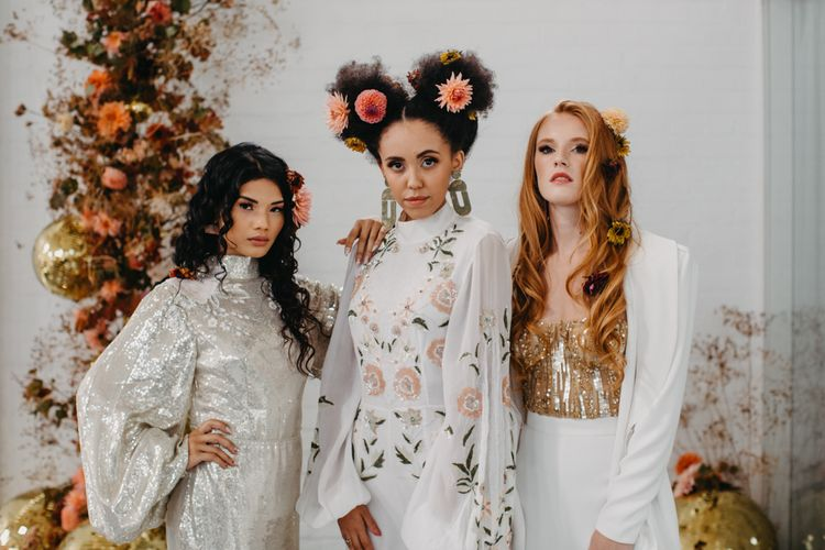 Stylish brides in sequin dress, embroidered jumpsuit and wedding trousers