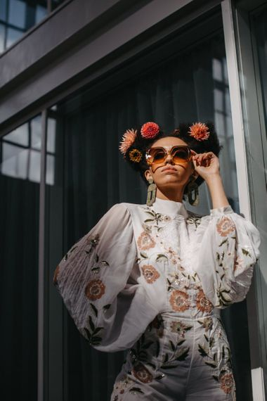 Stylish bride in floral jumpsuit for 70s Disco wedding inspiration