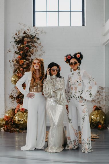 Stylish brides in sequin dress, embroidered jumpsuit and wedding trousers for 70s disco wedding inspiration