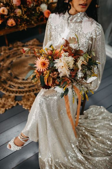 Autumnal wedding bouquet ties with ribbon