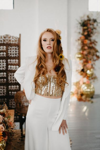 Beautiful bride in gold sequin corset and white trouser suit