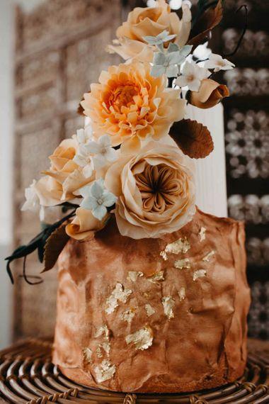 Wedding cake with gold leaf decor