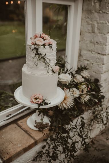 Two Tier Frosted Wedding Cake with Flower Decor | Romantic Pink and Gold Wedding Inspiration in a Modern Summer House at Garthmyl Hall by KnockKnockPenny Studio | Nesta Lloyd Photography