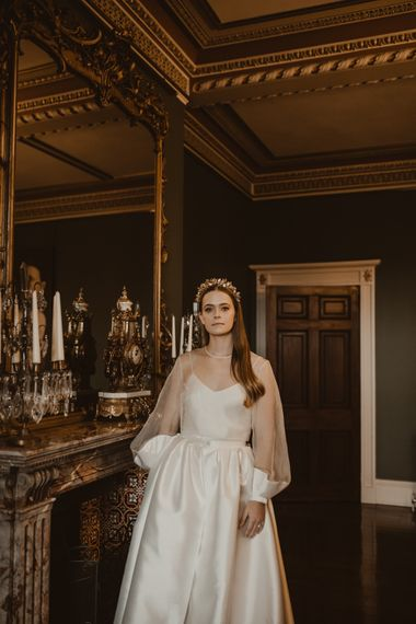Beautiful Bride in Sheer Front & Long Sleeved Wedding Dress with Gold Hair Band | Romantic Pink and Gold Wedding Inspiration in a Modern Summer House at Garthmyl Hall by KnockKnockPenny Studio | Nesta Lloyd Photography